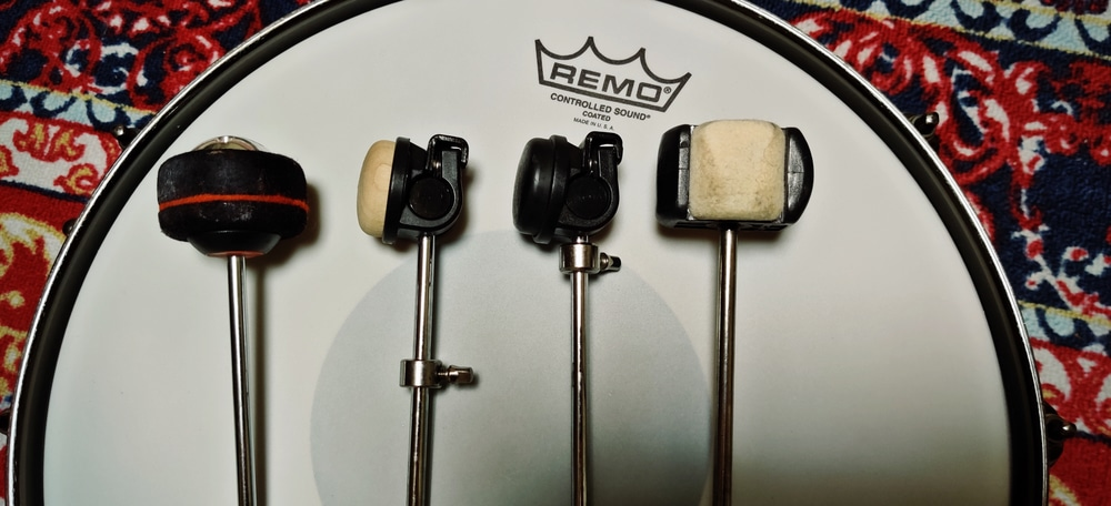 The bass drum beater - Pearl Demon Drive, Tama Iron Cobra plastic, Tama Iron Cobra wood, Pearl Quad Beater.